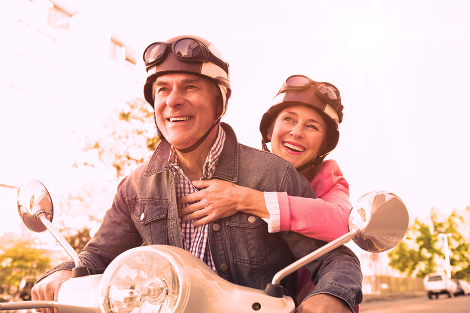 Image of Couple on Motorcycle Headed to Get Annuity Advice from Jim