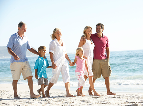 Family with Life Insurance Walking on Beach