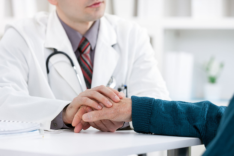 Physician Holding Medicare Patient Hand