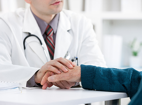 Doctor Holding Medicare Patient Hand